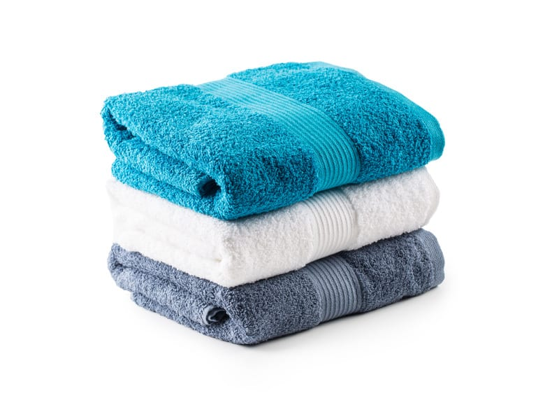 Stacked blue white and gray towels isolated on white - Air Quality Express Spring Dryer Vent Cleaning