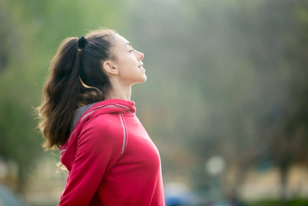 Sporty woman breathing fresh air - Air Quality Express