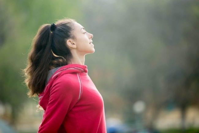 Sporty woman breathing fresh air - Air Quality Express